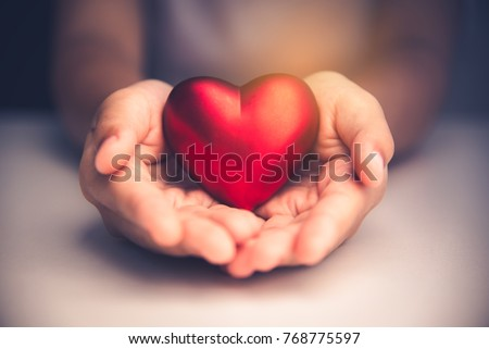 Hand give red heart for love #768775597
