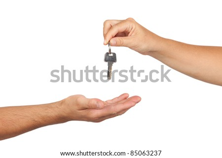 Hand giving a key isolated on white background