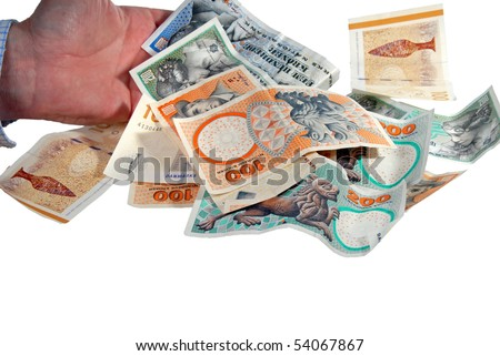 Hand giving a pile of Danish money