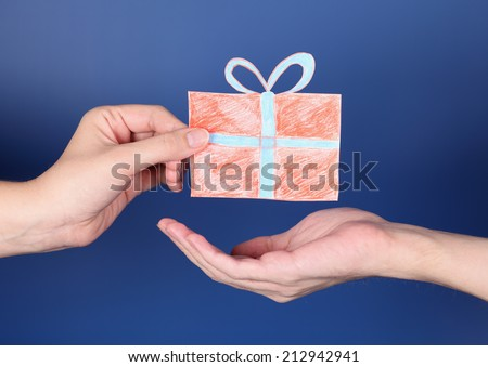 Hand giving a present to another one. Gift box is paper cut-out. #212942941