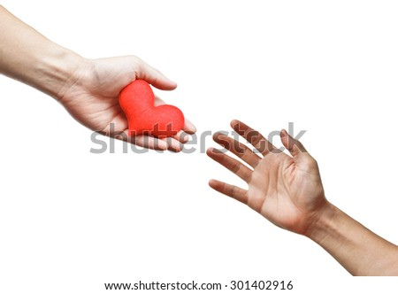 hand giving a red heart to...