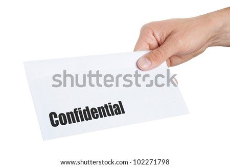 hand giving an envelope with Confidential on it