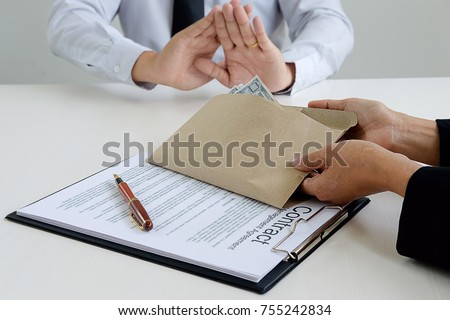 Hand giving money to other hand. anti Corruption concept #755242834