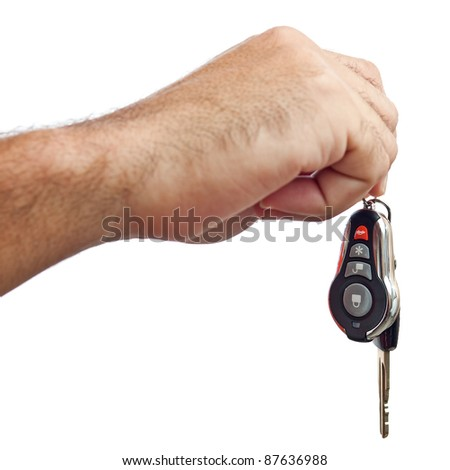 Hand giving out new car keys isolated on a white background