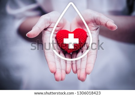 hand giving red heart for help blood donation hospital or healthcare concept.