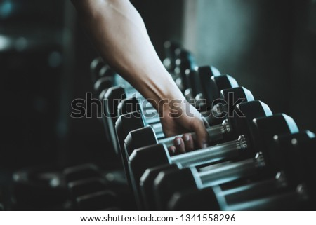 Hand grasp Dumb Bell from Rack of Fitness shop in Cool Tone