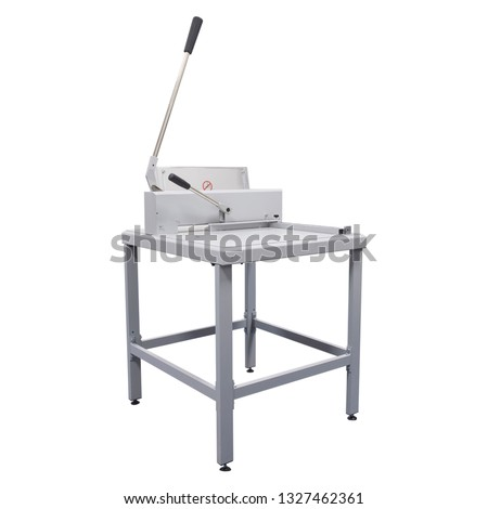 Hand guillotine cutter for paper stack isolated on white background. Stack white A3 #1327462361