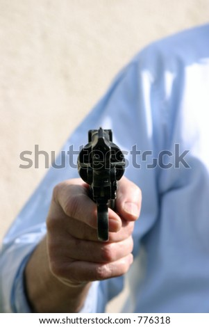 hand gun being pointed at YOU the viewer