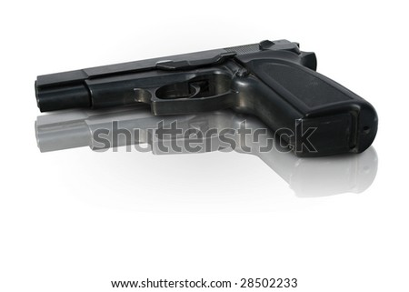Hand gun or pistol on shiny surface