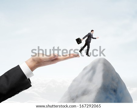 hand halped to jump to businessman