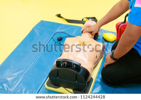 hand Heart pump with medical dummy on CPR, in emergency refresher training to assist of physician #1124244428
