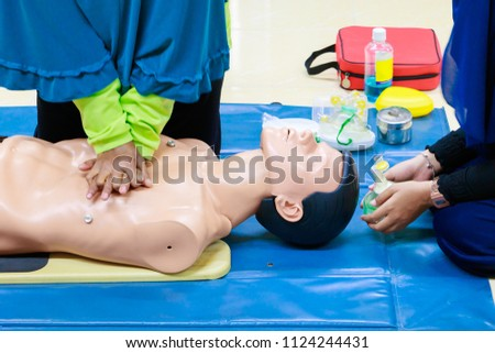 hand Heart pump with medical dummy on CPR, in emergency refresher training to assist of physician #1124244431
