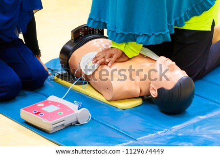 hand Heart pump with medical dummy on CPR, in emergency refresher training to assist of physician #1129674449