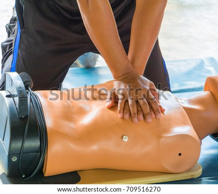 hand Heart pump with medical dummy on CPR, in emergency refresher training to assist of physician #709516270