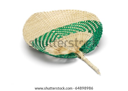 Hand held straw fan on white background