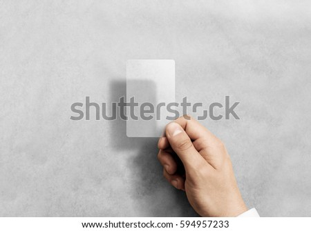 Hand hold blank vertical translucent card mockup with rounded corners. Plain clear call-card mock up template holding arm. Plastic transparent acrylic namecard display front.