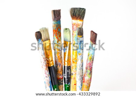 Hand hold Brushes and art supplies stock photo