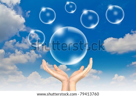 Hand hold Bubbles in the sky