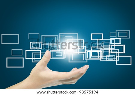 hand hold flying button or frame on touch screen PC - stock photo