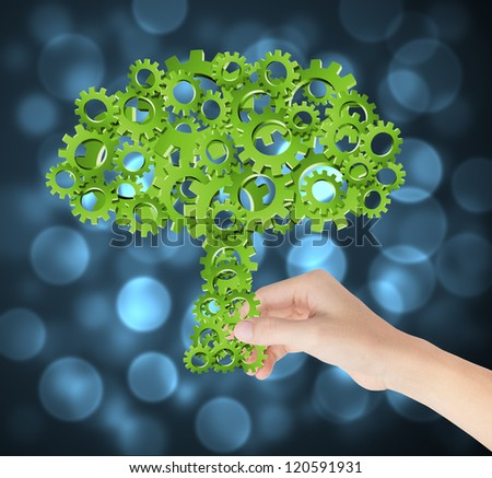 hand hold green tree of industrial gear, environmental concept