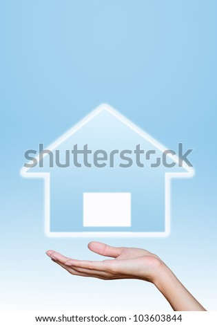 hand hold home icons on blue background.