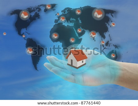 hand hold house for insurance concept with world map