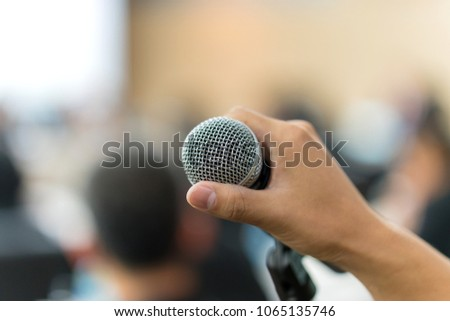 hand hold Microphone in meeting room for a conference. #1065135746