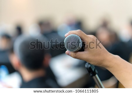 hand hold Microphone in meeting room for a conference. #1066111805