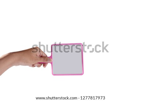 Hand hold pink mirror isolated on white background.