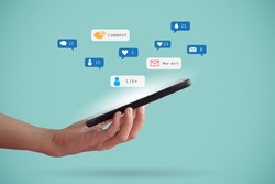 Hand hold smartphone play social media with communication icon. Technology concept.