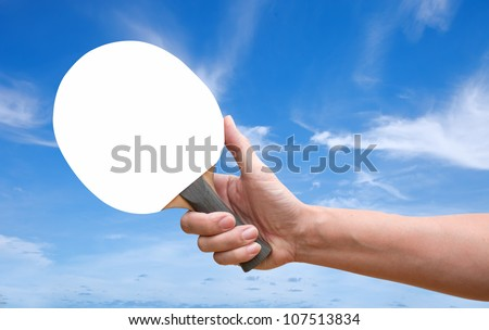 Hand hold Table tennis racket white screen over blue sky