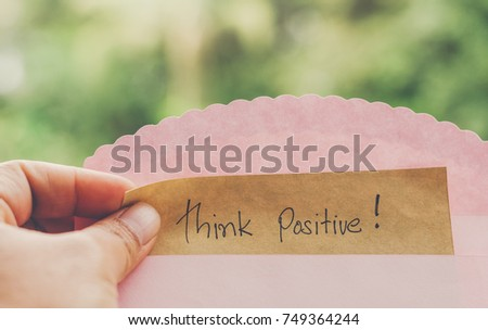 Hand hold think positive message on Brown paper Insert envelope concept instead Deliver send hope concern optimistic attitude mindset motivational intent inspire everyone feeling discouraged