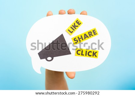 "Hand holding a announce with megaphone and the words ""LIKE"" ""SHARE"" ""CLICK"", on blue background. Social media and internet concept. Native advertising concept. Influencer marketing."