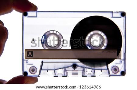 Hand holding a Audio Cassette close up shot