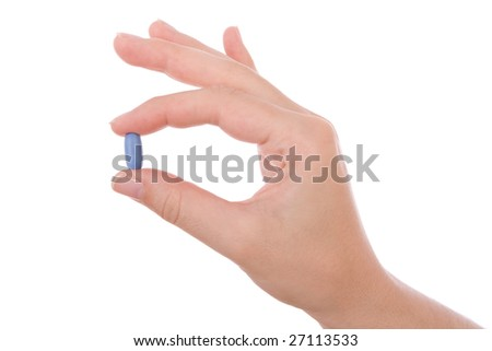 Hand holding a blue pill isolated on white