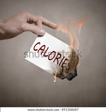 Hand holding a burning piece of paper with the inscription