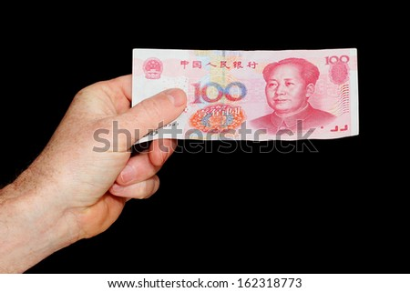 Hand Holding a Chinese One Hundred Yuan Note isolated on black