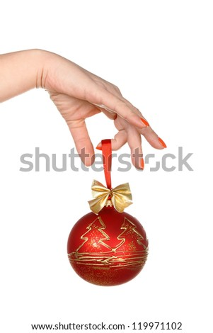 Hand holding a Christmas ornament