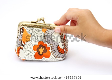 Hand holding a coin purse