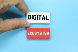 hand holding a colored block with the word digital ecosystem