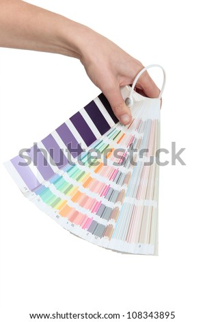 Hand holding a colour chart