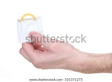Hand holding a condom isolated on white