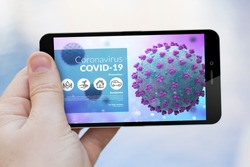 hand holding a covid-19 info website on smartphone screen. Screen graphics are made up.