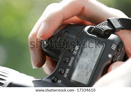 Hand holding a digital SLR camera