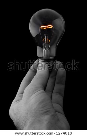 Hand Holding a Glowing Lightbulb on Black Background