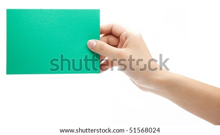 Hand holding a green color paper card (isolated on white)