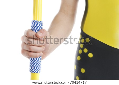 Hand holding a javelin, isolated on a white background.