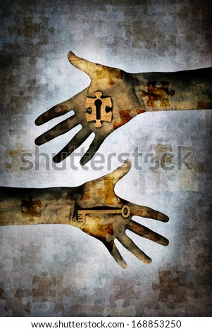 Hand holding a key alongside second hand holding a jigsaw piece with keyhole in centre against a grunge background of layered jigsaw pieces denoting mystery, secrecy, security, problem, solution, etc.