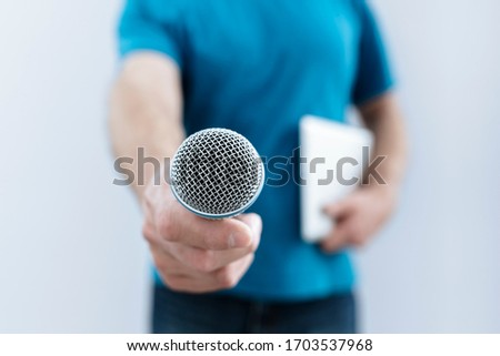 Hand holding a microphone conducting a business interview or press conference Stock photo ©