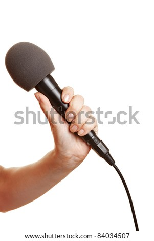 Hand holding a microphone with a windscreen